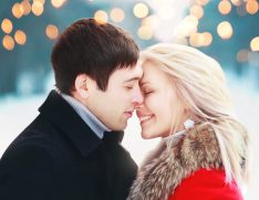 romantic couple, holiday lights, outdoor in winter